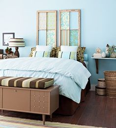 old windows as headboard and lovely calming colours giving the room a good feel to it