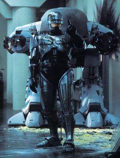 """zuppadivetro: lospaziobianco: temporalfluxinfinity: """"Es justo detrás de mí, no es él."""" ¿Quieres más en profundidad flujo temporal?  Revisa el blog original de Robocop."""