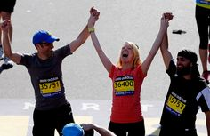 Adrianne Haslet-Davis crosses the finish line of the 2014 Boston Marathon with her brothers.  (Jim Rogash/Getty Images)
