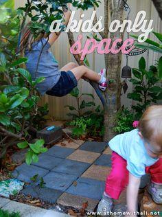 A secret space for kids built into a garden bed