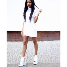 Click the photo to shop the look | Nelly N. of Bronzing Eyes wearing a mesh panel shift dress in white, and white platform buckle heels | | Follow @liketkit on Pinterest for more outfit inspiration #liketkit