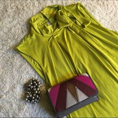 Chartreuse sleeveless top Gorgeous color and has a lot of give to the fabric. Buttons in the back with eyehole detail. In excellent condition Worthington Tops Blouses