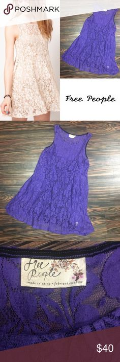 FREE PEOPLE Miles of Lace Dress This skater dress by Free People has been crafted from purple sheer lace with a black cotton jersey slip. The details include floral lace design with a round neckline and sleeveless styling. The dress has been cut with a gently flared fit. Size Medium GUC Free People Dresses