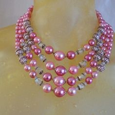 """Vintage 4- strand Pink Pearl & Beads Necklace Vintage lustruous pink pearls, borealis beads, metallic lace bead cages in a classic 4- strand style. 14""""(shortest strand) with 3"""" spacer. Excellent condition. Vintage Jewelry Necklaces"""