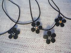 Using old bike inner-tubes punched with paper punches, I made necklaces. Found at Against the Wall Gallery.com