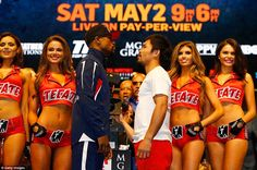 The stunning ring girls look on as Pacquiao and Mayweather focus on each other before the ...