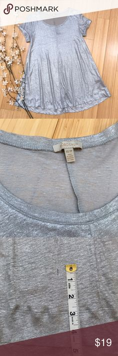 Anthropologie BORDEAUX silver tunic top, XS/S. This silvery metallic short sleeve tunic shirt by Anthropologie brand Bordeaux is 1000% awesome! Soft and stretchy, not itchy at all. Tagged XS but would easily fit a S. 100% linen. Bust measures 18 inches across and is stretchy, length is 28.5 inches. This is perfect and used condition except for one tiny run in the front, see picture. It is extremely small. Otherwise so cool! Anthropologie Tops Tunics