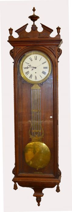 Antique Swiss Walnut Jewelers Regulator Clock: T.O. with an unsigned porcelain dial, lyre pendulum, the key and in a carved walnut case. Not tested.