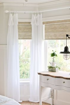 Curtain rod made with electrical conduit.  Curtains handmade with Joann fabrics - as seen in TIDBITS master bedroom reveal.