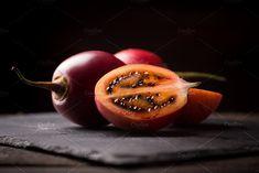 cloesup of tamarillo fruits by peterzsuzsa on @creativemarket