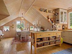 Beautiful and rustic designed open kitchen and dining room in Swedish house in Kungshamn.