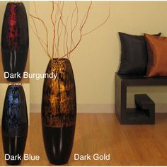 The hand-crafted tall 28-inch floor vase is a gorgeous addition to any decor. With a color accent at the top in your choice of dark blue, dark burgundy and dark gold, this vase includes natural branches that require assembly.