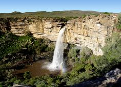 https://flic.kr/p/hunoR | Doorn River Waterfall, Northern Cape | This waterfall is situated a few miles north of Nieuwoudtville on the road to Loeriesfontein, in the Northern Cape (Namaqualand region), South Africa. The river plunges through an opening in the rock down a precipice of approximately 90 metres.  View large!  Stitched from 6 photos, and the sky is a photoshopped gradient due to too much noise and inconsistency in the stitch.