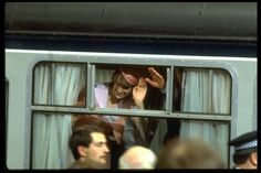 Here we see the happy couple waving goodbye from the train to start their honeymoon. ~~ July 29,1981.