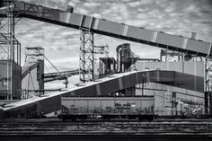 A Union Pacific hopper car is dwarfed by massive industrial equipment at the ADM Grain terminal at the Port of Galveston Texas.  See more #photos at 75central.com