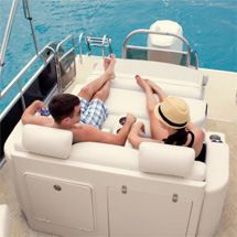 Pontoon Lounge chair folds down into Dinning area with seating on both sides. Manitou Pontoons