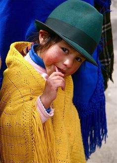 Ecuadorean tot sucking on a lollipop. There may be cultural differences, but inherently children around the world are more similar than they are different.