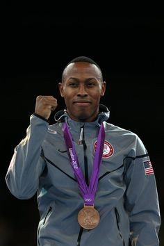 Bronze medalist Terrence Jennings of the United States celebrates on the podium during the medal ceremony for the Men's-68kg Taekwondo on Day 13 of the London 2012 Olympic Games at ExCeL on August 9, 2012 in London, England. (Getty Image