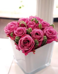 Pink Corporate flowers,  corporate flower centerpiece,  add pic source on comment and we will update it. www.myfloweraffair.com can create this beautiful flower look.