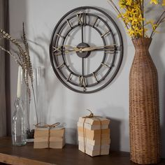 This industrial iron clock is a striking focal point in this room setting.