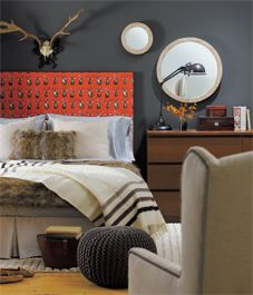 A cozy bedroom comes out of the winter cold with modern lodge elements on a fur or a fleece budget.