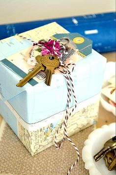 I love this idea, this particular one is for a Houswarming Gift....its a gift card wrapped in a map with old keys and such....great idea!