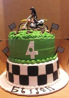 Dirt Bike Cake - 8 and 9 inch couble layer cakes, butter cream, mmf mom provided a pic and the toy bike