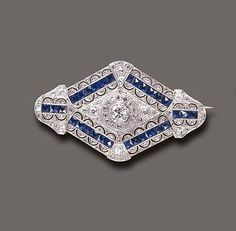 AN ART DECO SAPPHIRE AND DIAMOND BROOCH, Designed as a pierced old European and rose-cut diamond navette-shaped plaque, centering upon an old European-cut diamond within a rose-cut diamond surround, further accented by calibré-cut sapphire trim, mounted in platinum and gold, circa 1920