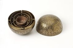 Perfume burner, unknown maker, ca. 1450-1500, Venice, pierced brass with silver damascening and black lacquer infill