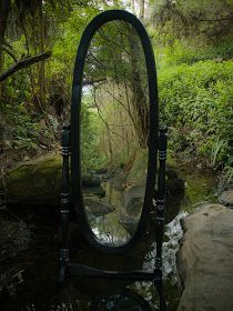 would be awesome to have bride (and maybe flower girl) look through the looking glass