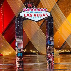 Our Welcome to Las Vegas Entrance has columns that look like the city lit up in the night sky accented with the lighted famous sign on the top.