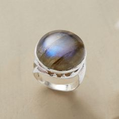 LABRADORESSENCE RING�--�Set in a scrolled sterling silver bezel, our colossal labradorite virtually explodes with iridescent hues. A handmade exclusive. Whole and half sizes 5 to 9.