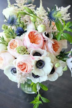 "Pretty Wedding Bouquet Featuring: White Anemones, White Astilbe, Blue Eryngium Thistle, Peach ""Juliet"" David Austin English Garden Roses, Greenery & Foliage"