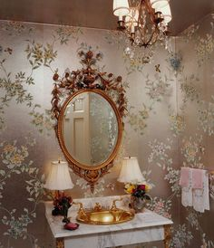 Gracie wallpapered powder room...Beautiful and elegant...and paired with Sherle Wagner sink equals the perfect powder room!