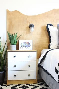This DIY Live Edge Headboard is so cute and an easy DIY project! Great project for beginners and can be completed in a couple hours!