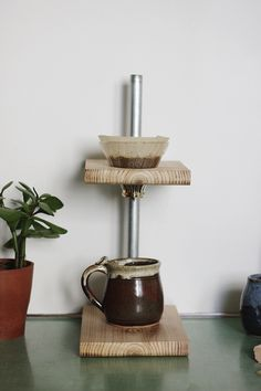 From cold brew to french press to simple stovetop setups, tons of my pals are tossing traditional coffee makers in favor of single-cup and small-batch alternatives. Make your own awesome DIY adjustable pour-over coffee stand! Coffee Brewer, Coffee Shop, V60 Coffee, Coffee Lovers, Coffee Coffee, Starbucks Coffee, Coffee Cups, Pour Over Coffee Maker, Coffee Stands