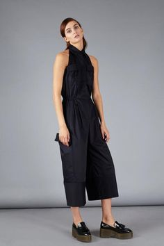 """Tapered overall with relaxed shirt cut, large patch pockets, drawstring waist and collar. Looks like a very trendy 'must have' piece, but stays practical. Quick option for a ready look. Details: Free cut coveralls, halter-neck, back cutout, front buttons, below the knees. Fabric: cotton 100% Color: navy blue  Model is 177cm/ 5'10"""" and is wearing a FR size 36 ----- About the brand: FLOW is a Belgian-Ukrainian fashion label for women who seek truly modern design. It is launched and run by…"""