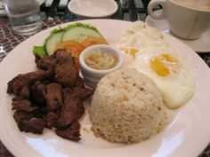 A Filipino favorite breakfast - tapa (marinated beef, cooked till well done), eggs, and garlic fried rice.