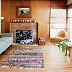 covering an unused fireplace and making it a kid-friendly area at the same time