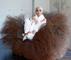Rossana Orlandi in a Carboneli chair. a.k.a chihuahua in a bird's nest. Guido Castagnoli photograph.