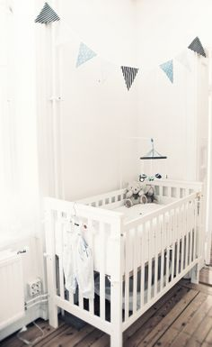 White nursery with bunting. Love this idea because you can add the bunting once the baby's born so you can buy pink or blue.