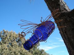 The best kind of garden bug. Copper wire and a bottle comes together to make this flying bottle bug by BearpawArtsandCrafts on Etsy.