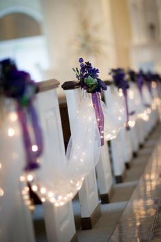 Chapel Ceremony Enhancements - Tulle Aisle Drape (White), Mini-Lights (White), Silk Floral Pew Decorations (Purple w/ greenery), Pew Sashes/Fabric Bow (Purple)
