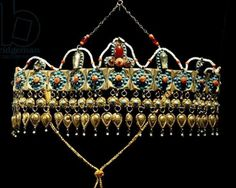 Uzbekistan: crown of silver-gilt, coral, turquoise and glass paste from Samarkand.