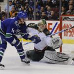 Robert Luongo made 25 saves as the Vancouver Canucks defeated the Minnesota Wild 2-1