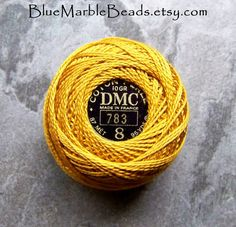 Beautiful vintage French embroidery floss, size 8, manufactured by Dollfuss-Mieg. Each Cotton Perle Ball contains 95 yards of vibrant marigold floss. You get 1 ball. Beautiful vintage item