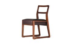This Weiland Side Chair features Solid American walnut and Genuine black leather seating