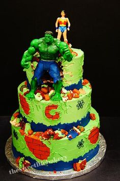 The most awesome themed wedding cake, Hulk and Wonder Woman!