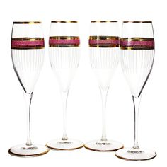 Pairing these champagne flutes with soft white and pops of pinks will give your table setting a fresh, summer feel. (SOLD)