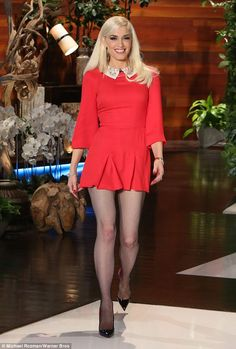 Newly single: The stunning singer, who wore a red mini dress with black stockings for a ta...